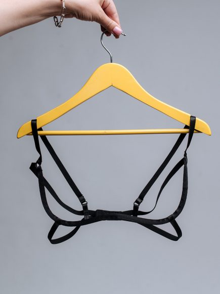 Decorative caging bra with adjustable table slides